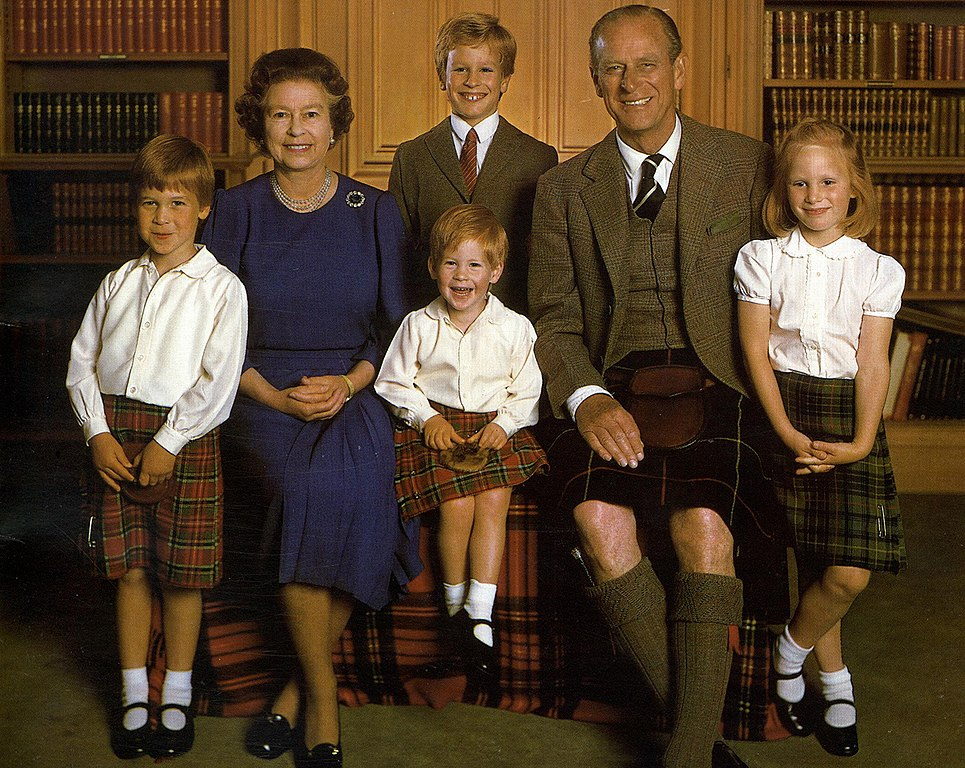 Harry (seated) on a 1987 Christmas card with his grandparents, brother, and cousins Peter and Zara Phillips