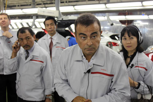 Carlos Ghosn answers reporters' questions at the Nissan factory in Kyushu, Japan.From Wikimedia Commons,